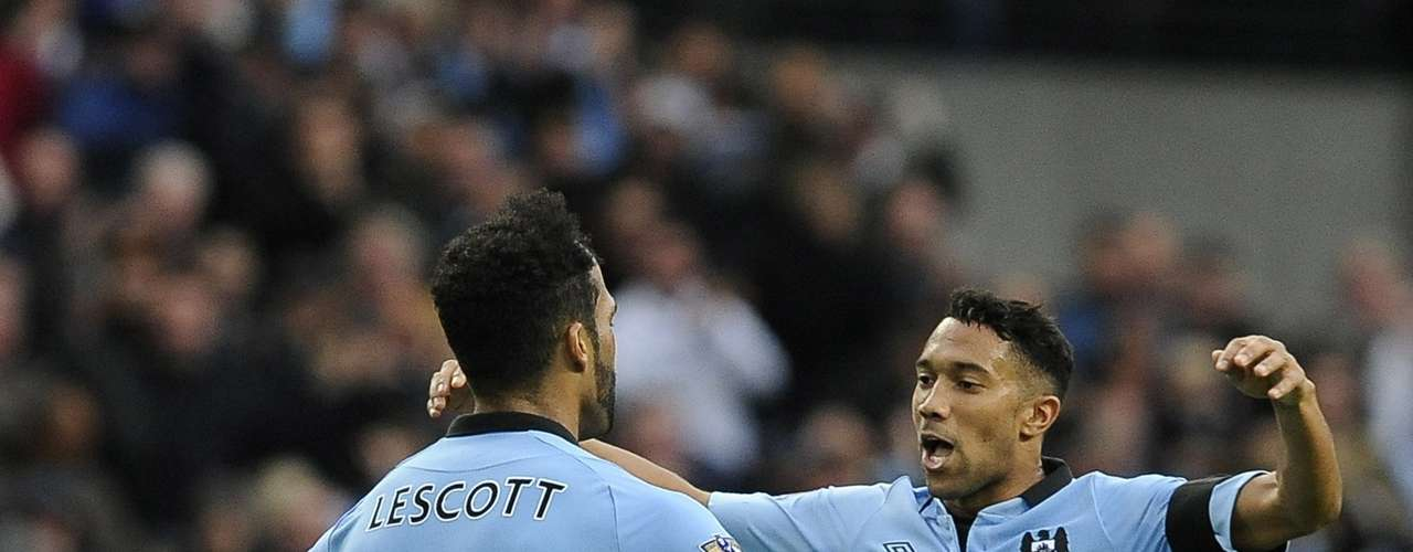 Lescott celebrates with teammate Gael Clichy after scoring.