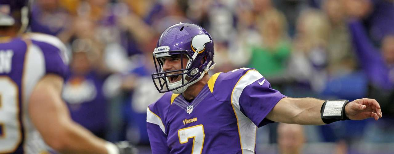Minnesota Vikings quarterback Christian Ponder (7) celebrates after he sprints 23 yards for a touchdown during the first half of the Vikings' NFL football game against the San Francisco 49ers in Minneapolis, September 23, 2012.