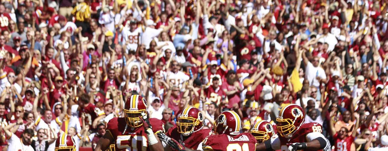Washington Redskins linebacker Rob Jackson (50) celebrates a touchdown against the Cincinnati Bengals during the first half of their NFL football game in Landover, Maryland September 23, 2012.