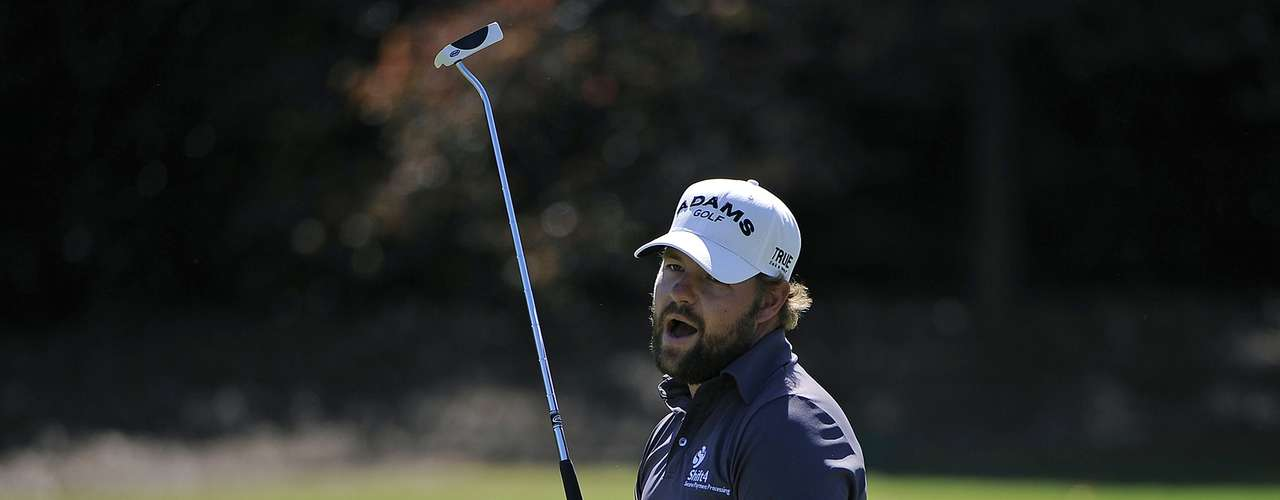 Ryan Moore of the U.S. reacts after missing a birdie attempt and settles for par on hole five during the final round of the Tour Championship golf tournament at the East Lake Golf Club in Atlanta, Georgia, September 23, 2012. REUTERS/David Tulis (UNITED STATES - Tags: SPORT GOLF)