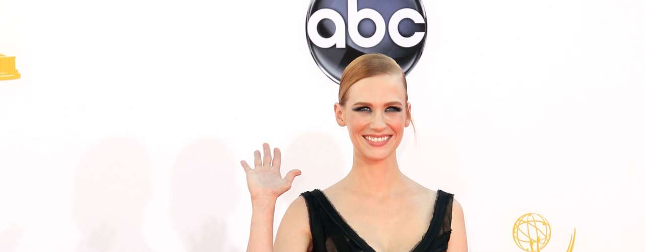 January Jones absorbed all the heat with this black dress, but it quickly escaped through strategic places.