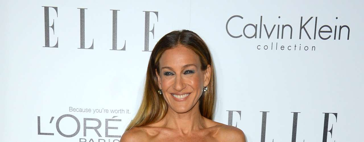 Sarah Jessica Parker looks classy in this Calvin Klein. Someone do something with her hair, please.