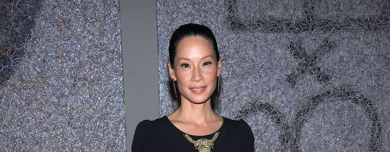 Lucy Liu was all smiles while at the book launch for 'Connecting The Dots.' The exhibition opening was held at the Urban Zen Center in New York. The 'Elementary' actress wore a basic black dress with black stockings. What did you think of Lucy's style?