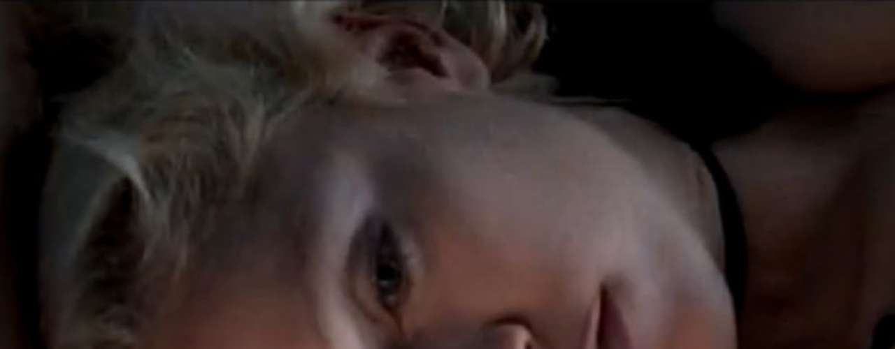 The video begins with a shocking image of Madonna's dead, strangled body.