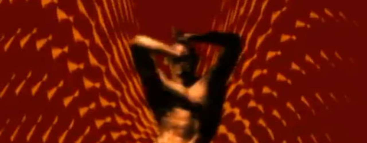 Scenes also include thong-clad men dancing in front of funky, psychedelic backgrounds.