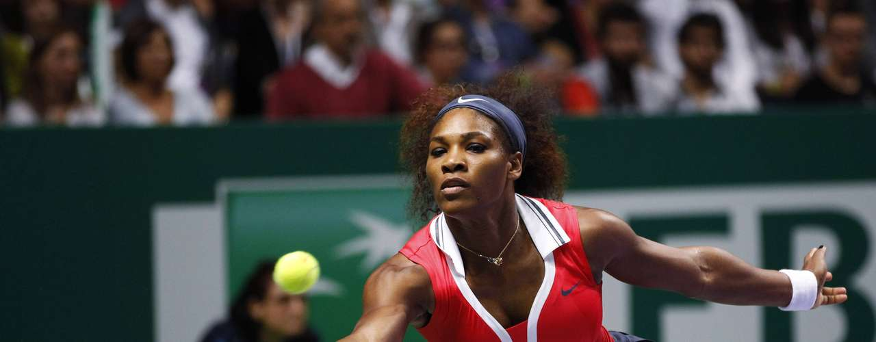 Serena Williams of the U.S. hits a return to Russia's Maria Sharapova during their final WTA tennis championships match in Istanbul, October 28, 2012.