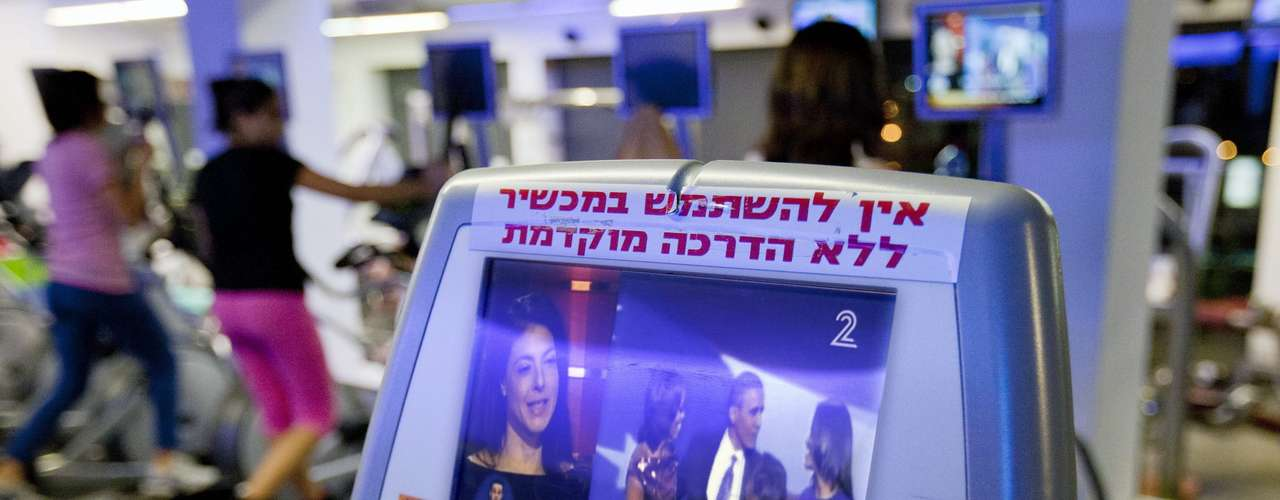 A television monitor at a gym shows news about the elections outside of Jerusalem, Israel.