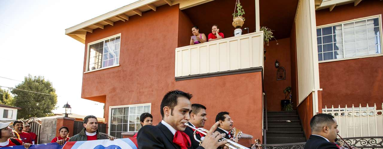 To the rhythm of mariachi music, these voters stand in line in Sun Valley, Los Angeles, California.