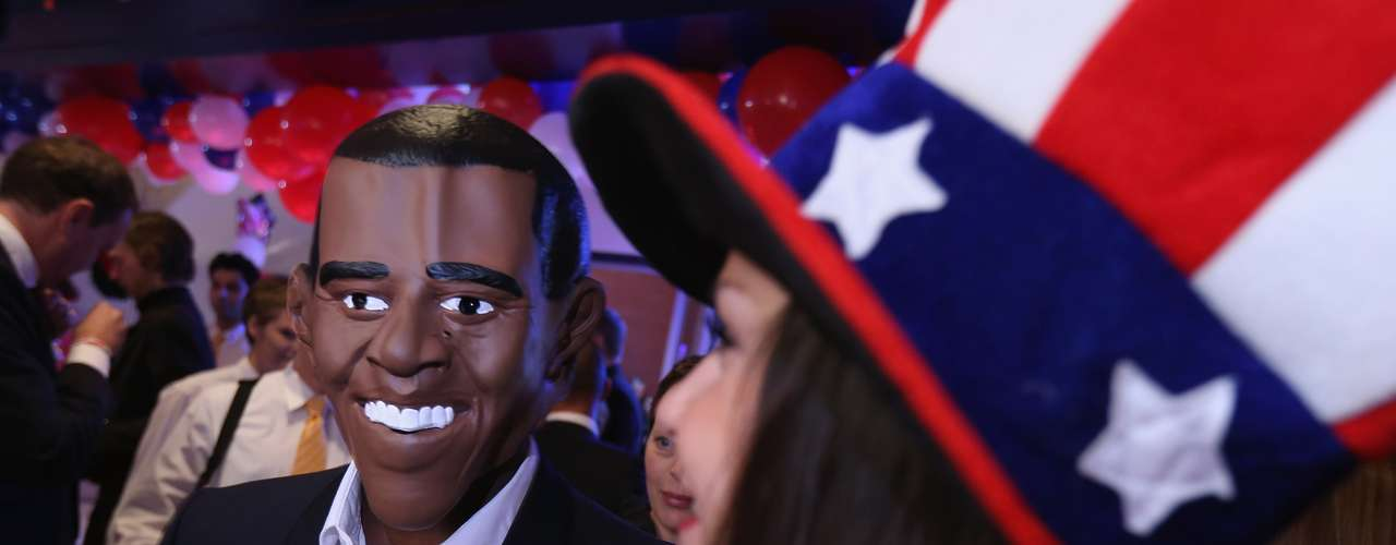 An actor with a mask of president Obama has fun at a Bertelsmann Foundation to celebrate in Berlin, Germany.