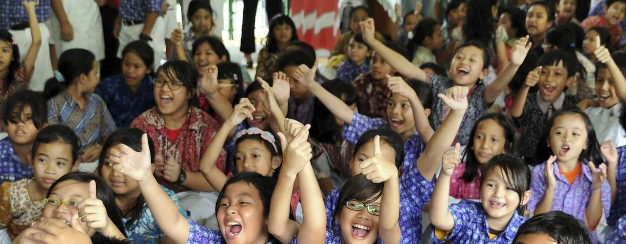 Elementary school students in the school Menteng 01 in Indonesia celebrate after hearing the results of the American elections.