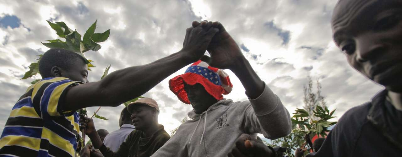 Obamas Kenyan supporters dance due to their excitement in his fathers hometown of Kogelo.