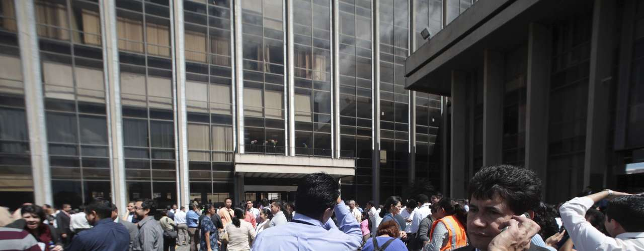 Office workers were forced to evacuate their buildings as the earthquake hit.