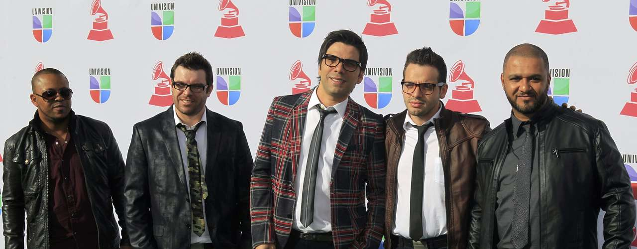 Gospel singer Paulo Cesar Baruk (C) and the band Salluz arrive at the 13th Latin Grammy Awards in Las Vegas, Nevada, November 15, 2012. REUTERS/Steve Marcus (UNITED STATES  - Tags: ENTERTAINMENT)