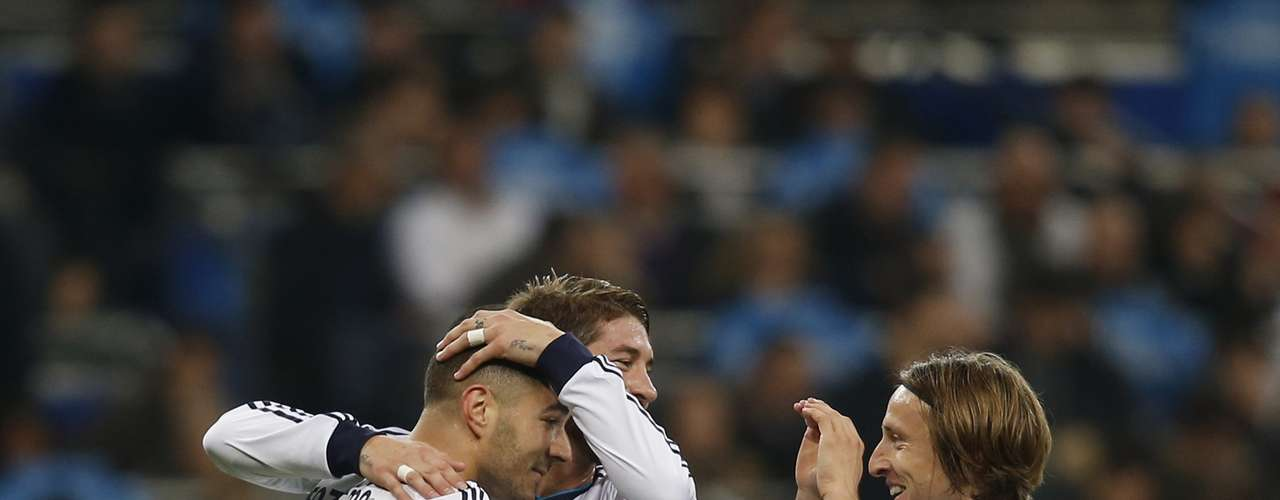 Real Madrid's Karim Benzema (L) is congratulated by teammates Sergio Ramos (C) and Luka Modric.