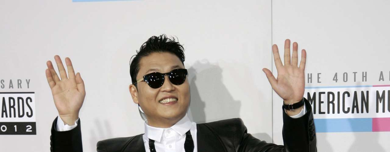 South Korean rapper Psy poses as he arrives at the 40th American Music Awards in Los Angeles, California, November 18, 2012.