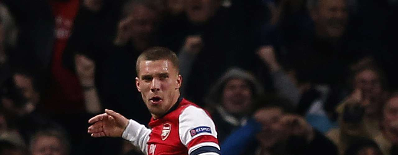 Arsenal's Lukas Podolski celebrates his goal against Montpellier during their Champions League Group B soccer match in London November 21, 2012.