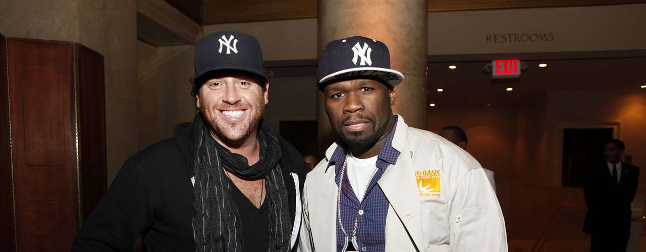 50 Cent, right, and Food Network's Scott Conant join Feeding America and the Food Bank for NYC to serve Thanksgiving meals to people in need at Cipriani on Wednesday, November 21, 2012 in New York.
