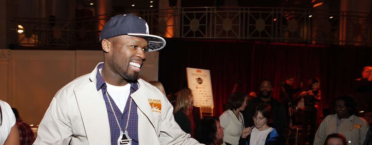 50 Cent greets people affected by Hurricane Sandy and joins Feeding America and the Food Bank for NYC to serve Thanksgiving meals to people in need at Cipriani, on Wednesday, November 21, 2012 in New York.