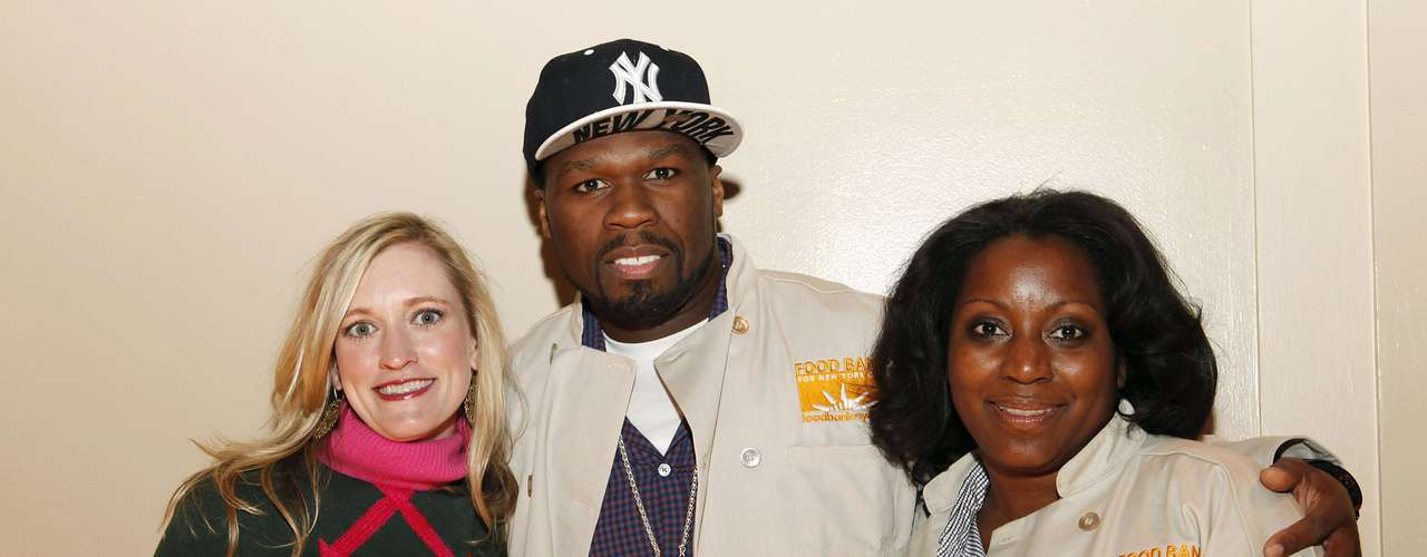 From left, Maura Daley, chief communication and development officer, 50 Cent and Margaret Purvis, FoodBank For New York City President and CEO, join Feeding America and the Food Bank for NYC to serve Thanksgiving meals to people in need at Cipriani on Wednesday, November 21, 2012, in New York.