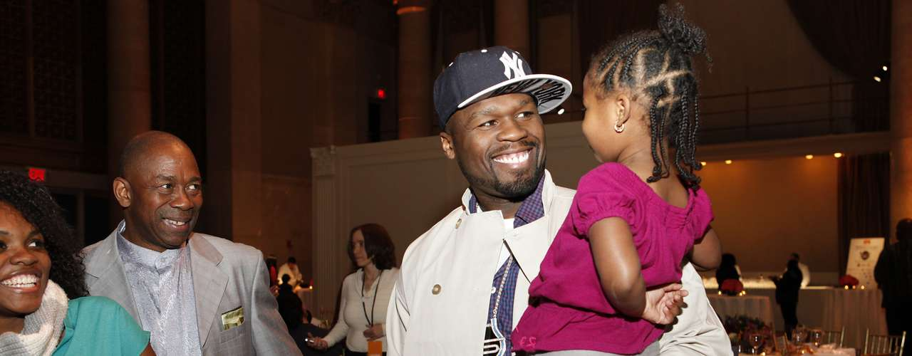 50 Cent greets people affected by Hurricane Sandy and joins Feeding America and the Food Bank for NYC to serve Thanksgiving meals to people in need at Cipriani, on Wednesday, November 21, 2012, in New York.