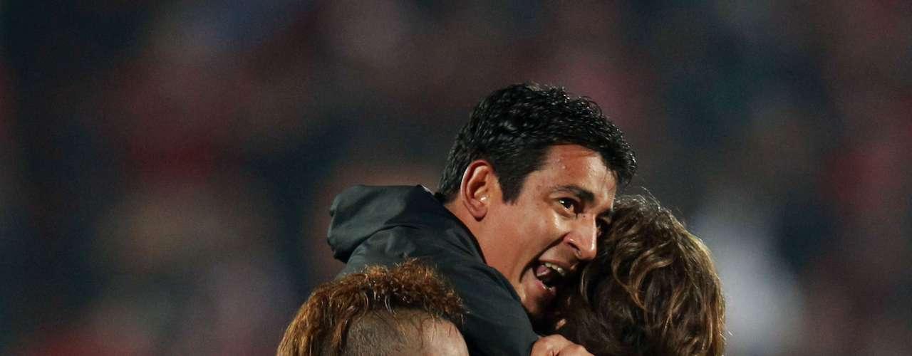 Cirilo Saucedo celebrates with teammates.