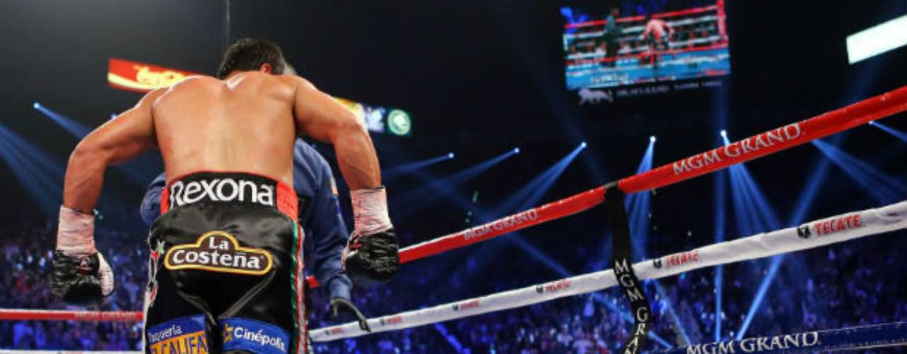At the end of the sixth round, a strong right jab by Marquez knocked Pacquiao out cold.