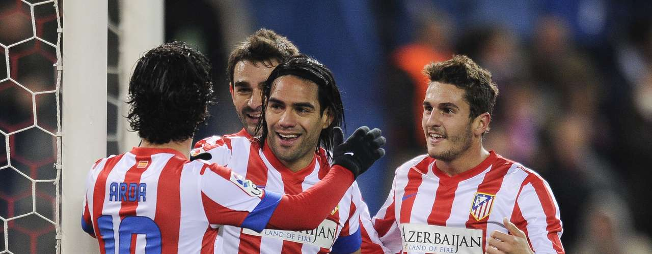 Falcao is congratulated by his teammates.