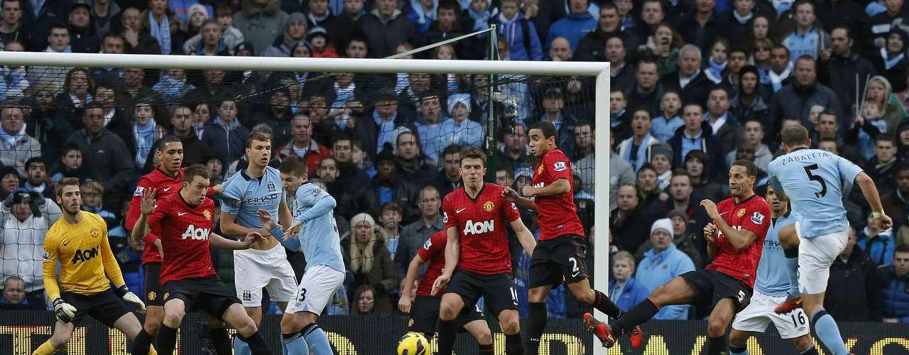 Manchester City's Pablo Zabaleta (R) shoots to score.