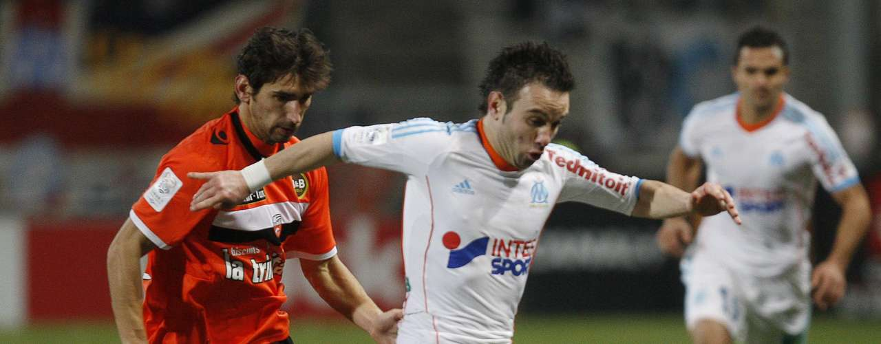 Olympique Marseille's Mathieu Valbuena (R) challenges FC Lorient's Pedrinho during their French Ligue 1 soccer match at the Velodrome Stadium in Marseille, December 9, 2012.