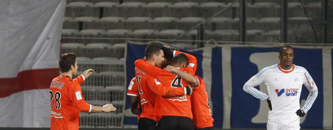 FC Lorient's players celebrate Benjamin Corgnet's goal against Olympique Marseille during their French Ligue 1 soccer match at the Velodrome Stadium in Marseille, December 9, 2012.