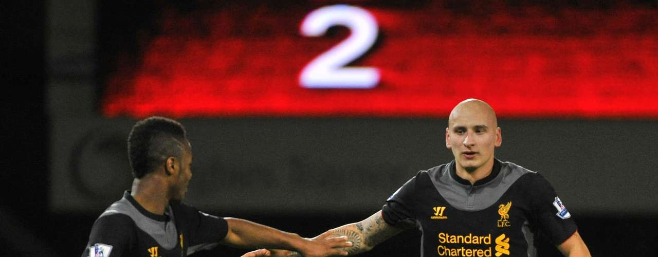Liverpool's Jonjo Shelvey (R) celebrates with team mate Raheem Sterling after scoring a goal against West Ham during their English Premier League soccer match at Upton Park in London December 9, 2012.
