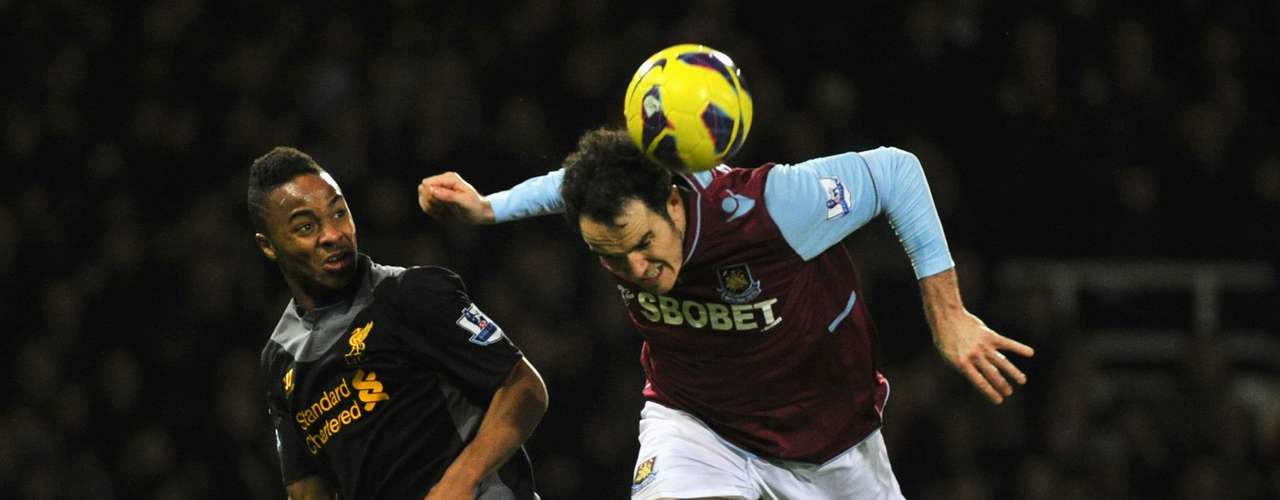 West Ham's Joey O'Brien (R) is challenged by Liverpool's Raheem Sterling during their English Premier League soccer match at Upton Park in London December 9, 2012.