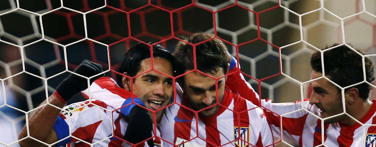 Radamel Falcao (L) celebrates his second goal against Deportivo with teammates Jorge Resurreccion Koke (C) and Adrian Lopez