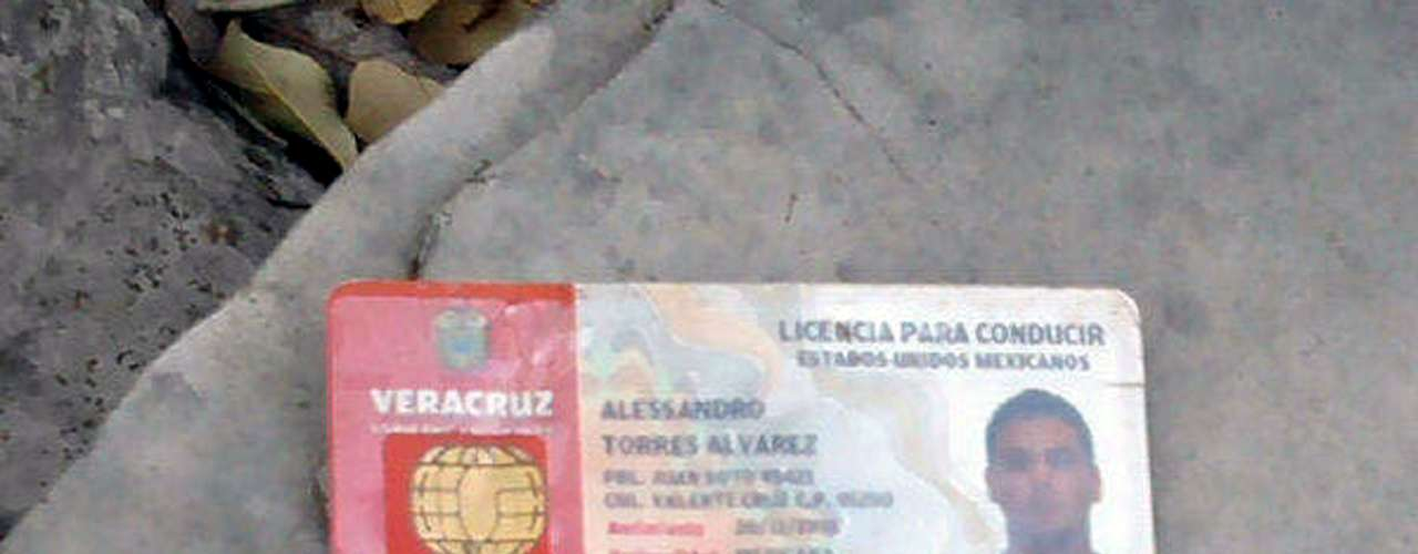 The ID of Alessandro Torres, one of the plane's pilots, was also found there.