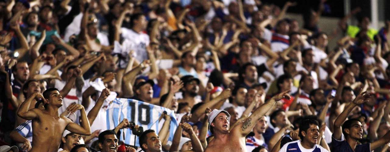 Fans of Argentina's Tigre cheer before their team plays Brazil's Sao Paulo. REUTERS/Nacho Doce