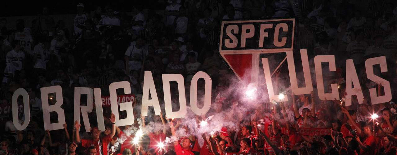 Fans of Brazil's Sao Paulo hold up letters to form the message, \