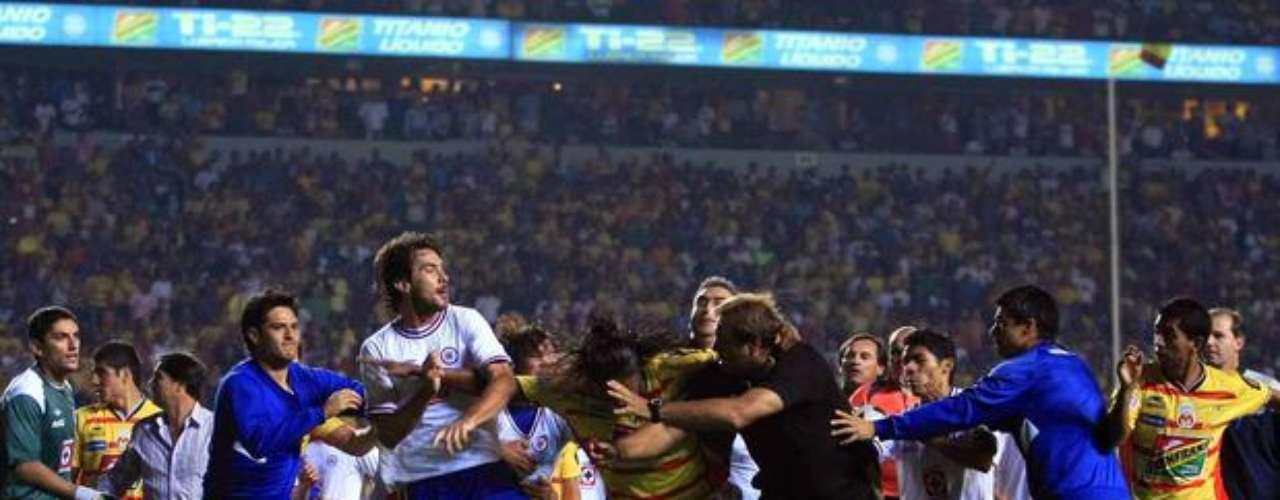 In the semi-finals of the Clausura tournament in Mexico in 2011,players and coaches from Morelia and Cruz Azul engaged in fisticuffs, after a fan jumped onto the field and made mocked one of the teams.