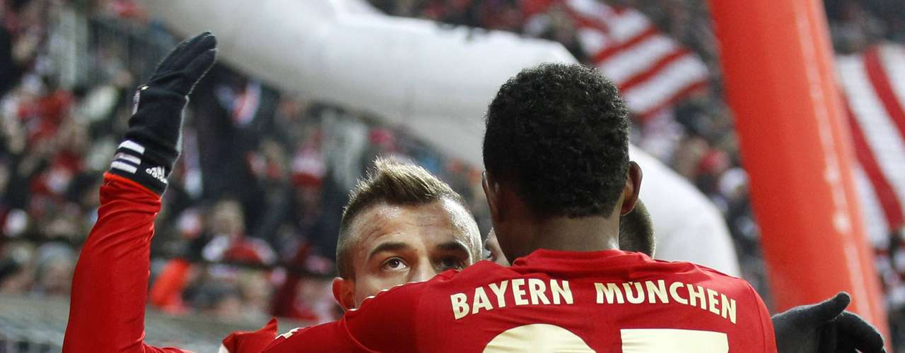 Bayern Munich's Xherdan Shaqiri (L) celebrates with David Alaba after scoring a goal during . REUTERS/Dominic Ebenbichler