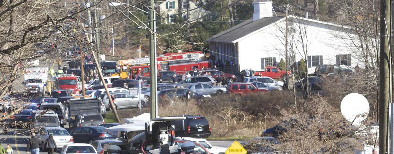 The scene at Sandy Hook Elementary School in Newtown, Connecticut, December 14, 2012. A shooter opened fire at the elementary school in Newtown, Connecticut, on Friday, killing several people including children, the Hartford Courant newspaper reported. REUTERS/Michelle McLoughlin (UNITED STATES - Tags: CRIME LAW EDUCATION)