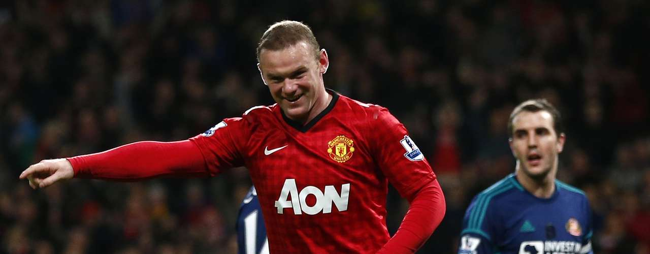 Manchester United's Wayne Rooney celebrates his goal against Sunderland during their English Premier League soccer match at Old Trafford in Manchester, northern England, December 15, 2012.