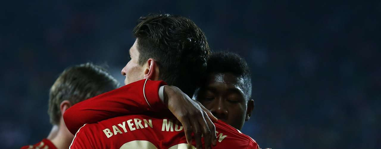 Bayern Munich's Mario Gomez celebrates with David Alaba after he scored against Augsburg during their German DFB Cup (DFB Pokal) round of sixteen soccer match in Augsburg December 18, 2012.