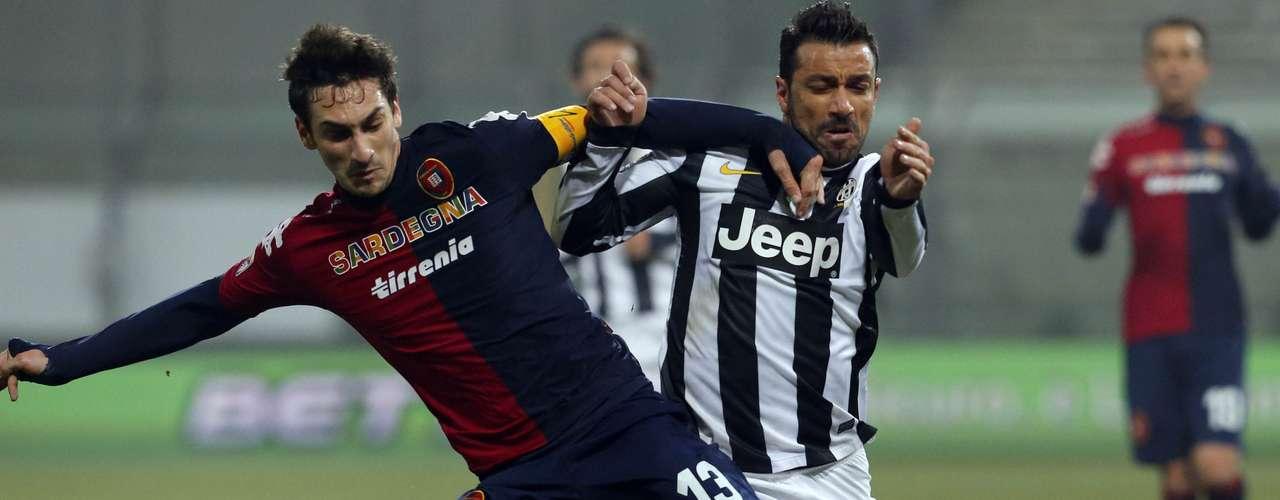 Juventus' Fabio Quagliarella (R) challenges Davide Astori of Cagliari.