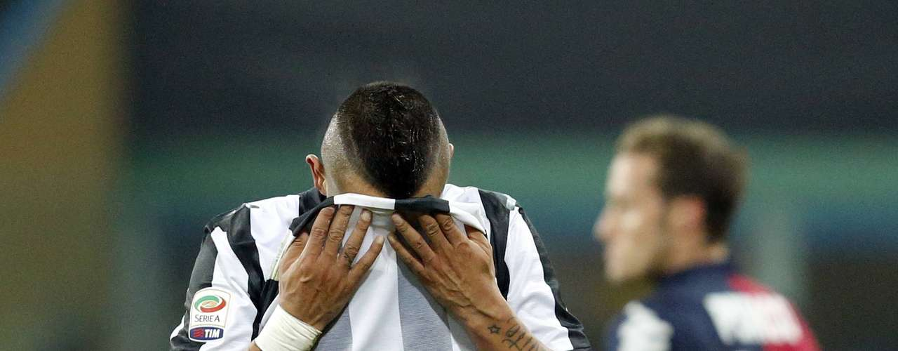 Juventus' Arturo Vidal reacts after missed a penalty kick against Cagliari.