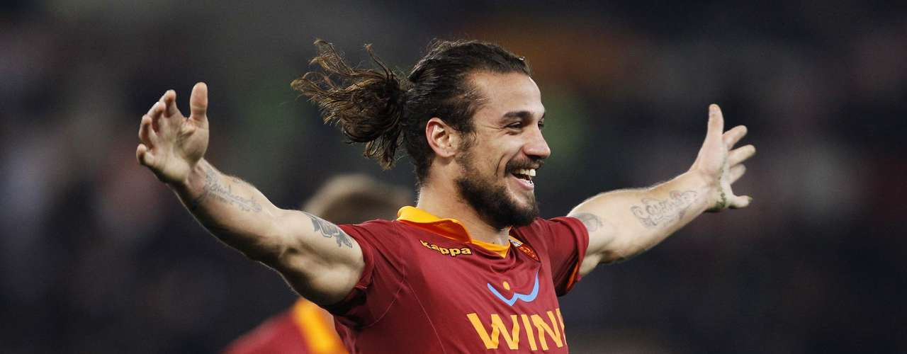 AS Roma's Daniel Pablo Osvaldo celebrates after scoring against AC Milan.