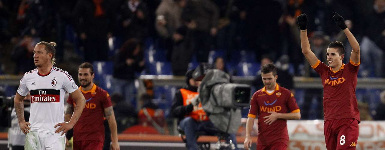 AS Roma's Erik Lamela (R) celebrates after scoring against AC Milan. Lamela had a brace in the game.