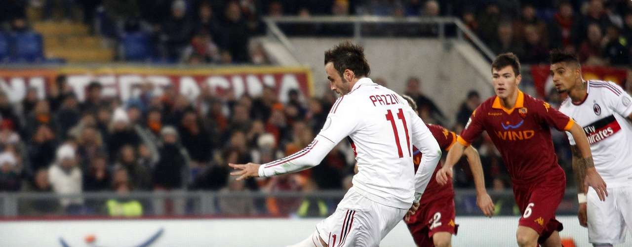 AC Milan's Gianpaolo Pazzini scores a penalty during their Italian Serie A soccer match.