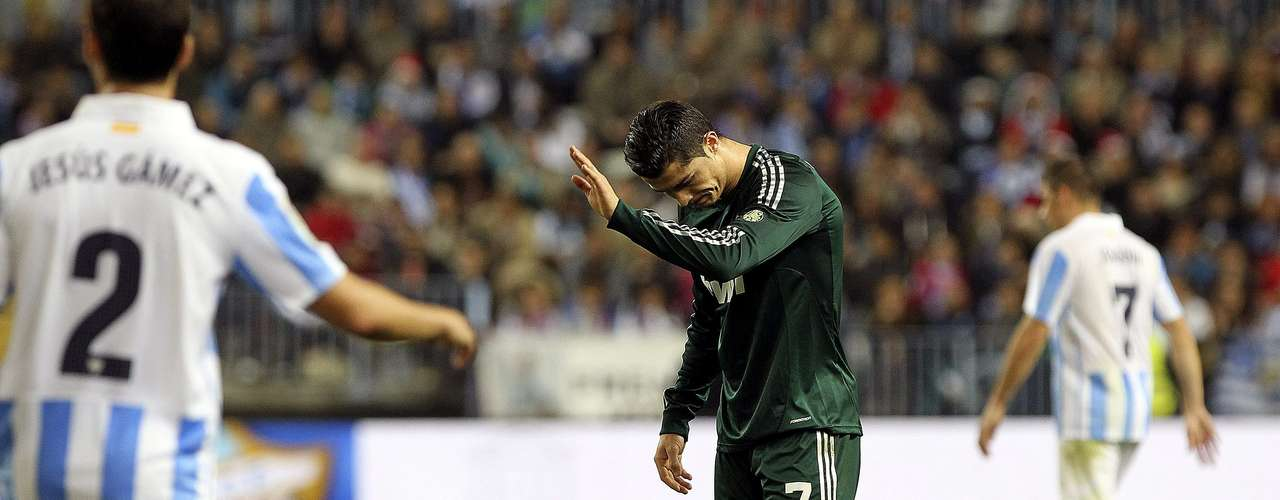 Cristiano Ronaldo reacts after missing a clear scoring opportunity in the first hal.