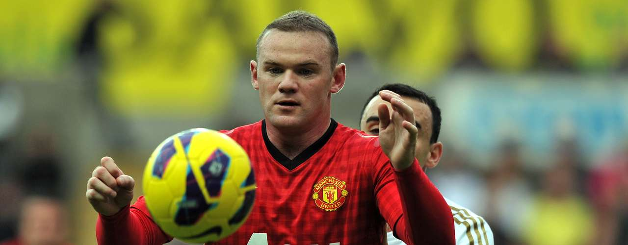 Wayne Rooney controls the ball from pressure from Leoan Britton.