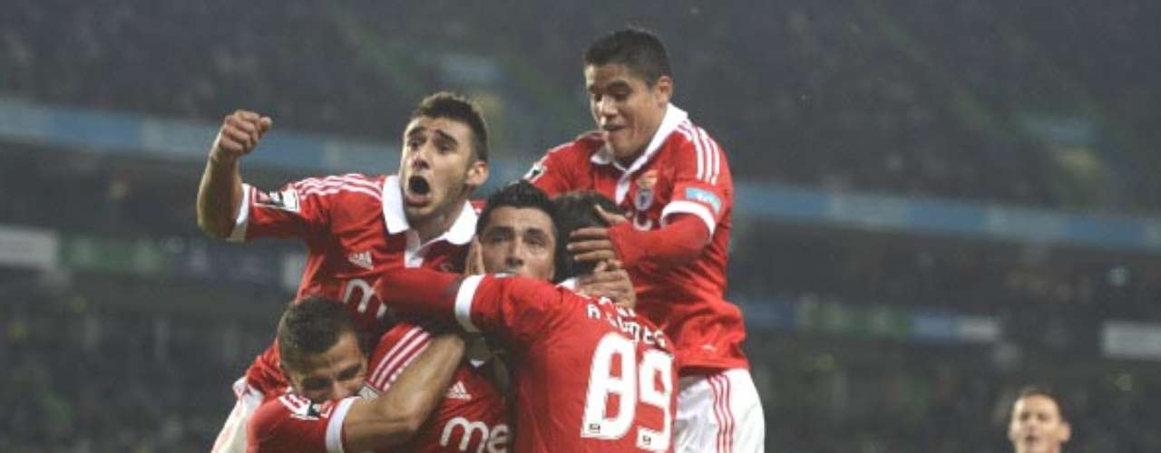 In the Portuguese Liga, Benfica is holding off Porto, who has one less game played. They are currently the leaders with 32 points in 12 matches.