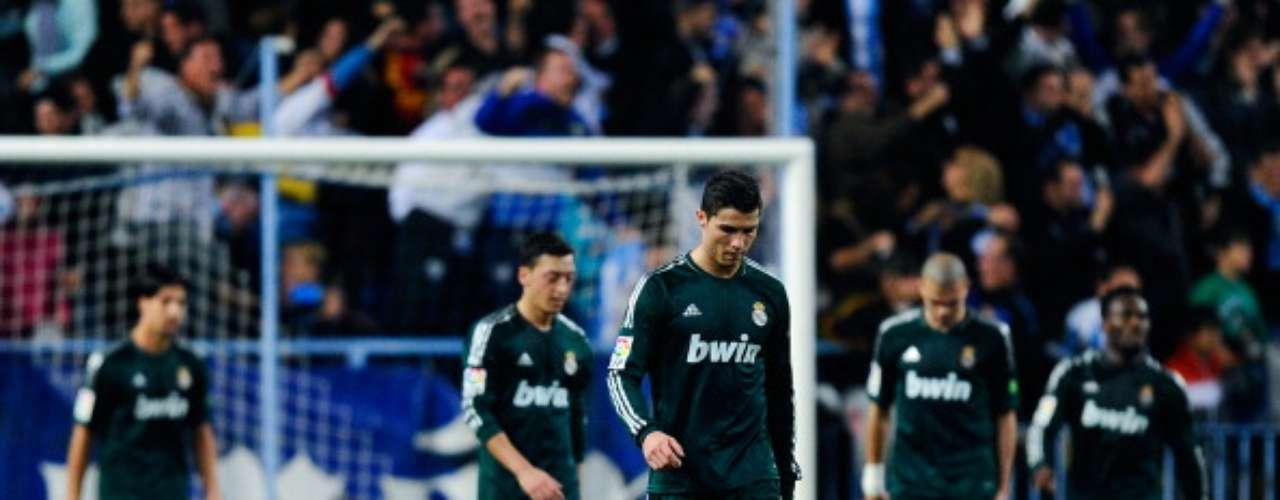 El Madrid prácticamente dejó ir el título con su derrota (3-2) en Málaga, quedando a 16 puntos de los Culés.